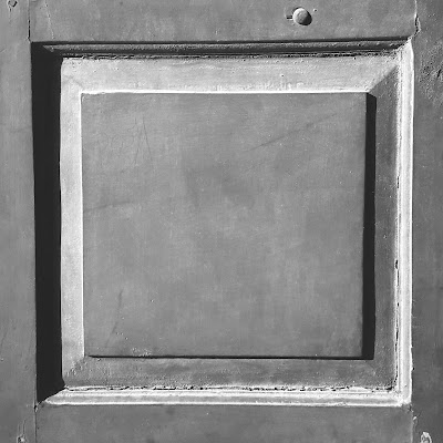A black and white Minimalist Photo of a wooden square shot by Samsung Galaxy S6 Mobile Phone