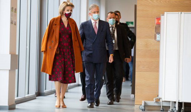 Queen Mathilde wore a new faux wrap cotton dress from Dries Van Noten, and a wool cahmere coat from Natan, and Natan pumps