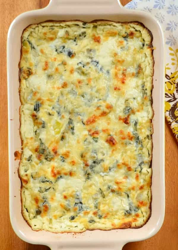 Hot Spinach Artichoke Dip is a favorite appetizer for any type of gathering. Whether we need an easy Thanksgiving appetizer or snacks for Super Bowl. Spinach Artichoke Dip is a creamy cheesy dip made with cream cheese, sour cream, a little mayo, and parmesan cheese as a base for fresh spinach and artichoke hearts from Serena Bakes Simply From Scratch.