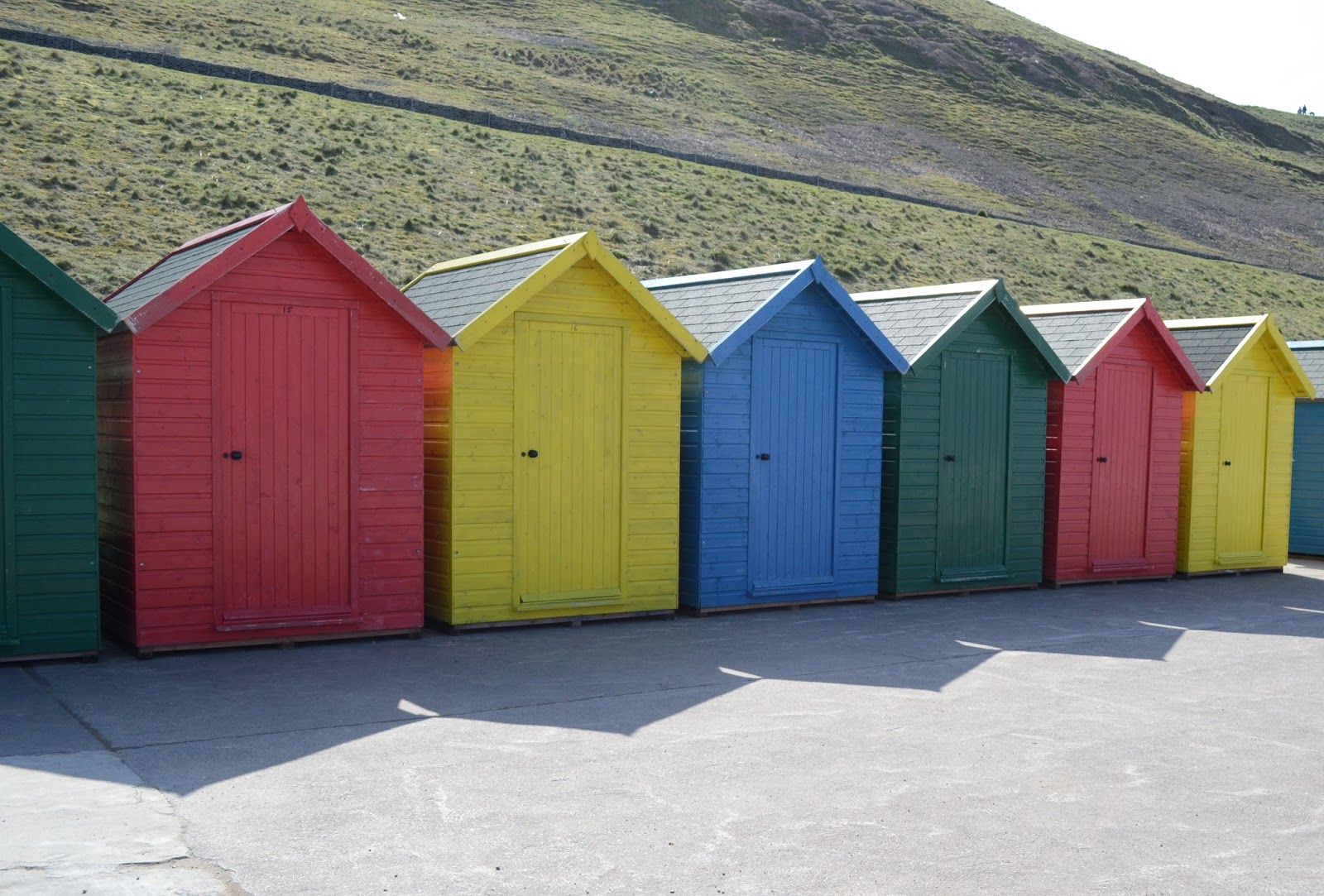 Multi coloured beach huts, English coastline, Whitby bay, picturesque