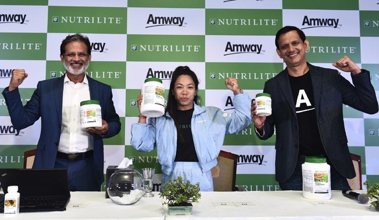 Anshu Budhraja, CEO Amway India, Saikhom Mirabai Chanu and Ajay Khanna CMO Amway India at the Nutrilite brand ambassador announcement Press conference