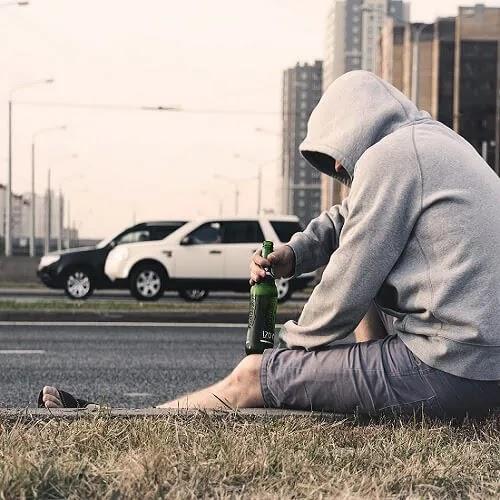 alone boy drinking