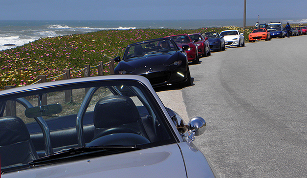 Parked Miata Lineup with Pacific Ocean