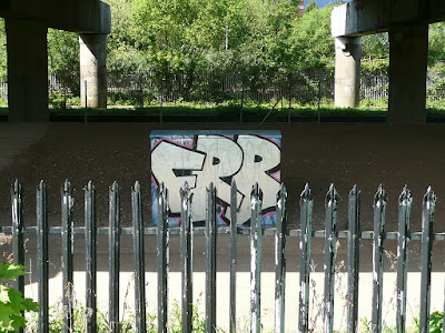 graffiti-box-behind-fence