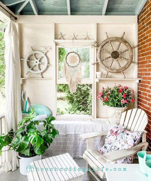 Cozy Nautical Porch Idea with Ship Wheel Wall Decor