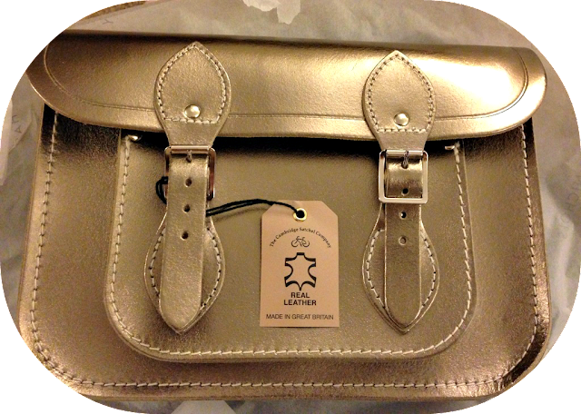 A picture of the outside of a Camrbidge satchel company satchel showing the pockets and the leather with the label and tag still attached
