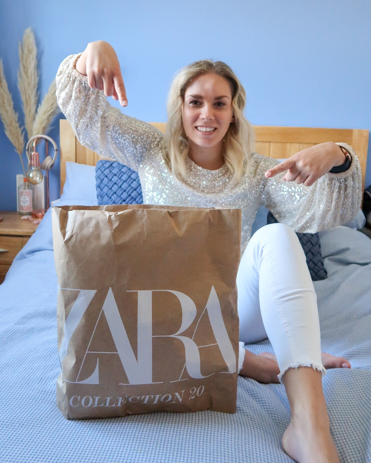 Rachel Emily in a sequin top with a large Zara online delivery parcel