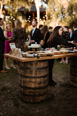charcuterie display on whiskey barrel table
