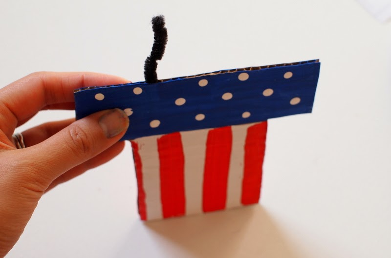 stick pipe cleaners into your cardboard Fourth of July Hat bottom