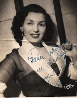Autografo sobre fotografia de Emílinha Borba