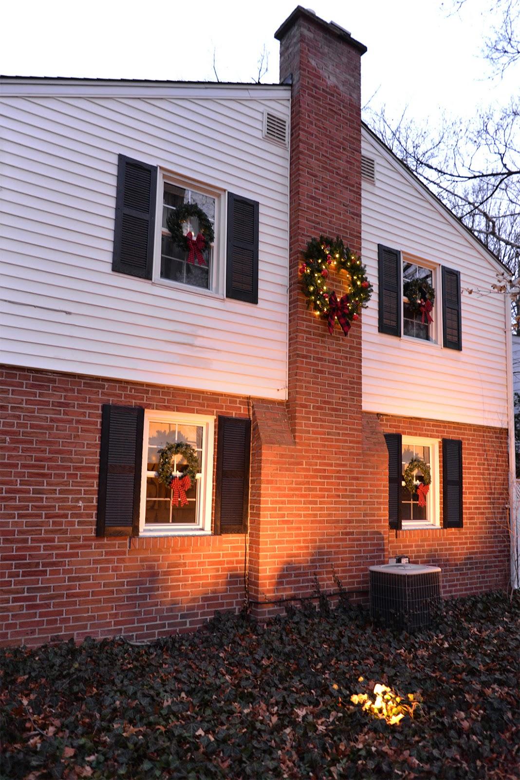 wreath on chimney, wreaths on every window, candles in window wreaths