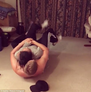 Heather wrestling her boyfriend Llyod in their house