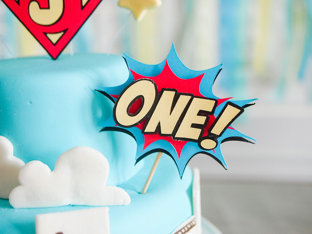 DIY Superhero Cake with marshmallow fondant and handmade cake toppers