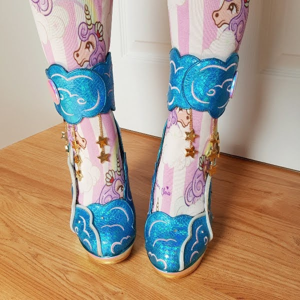 wearing vivid blue shoes with gold dangling stars and ankle cuff