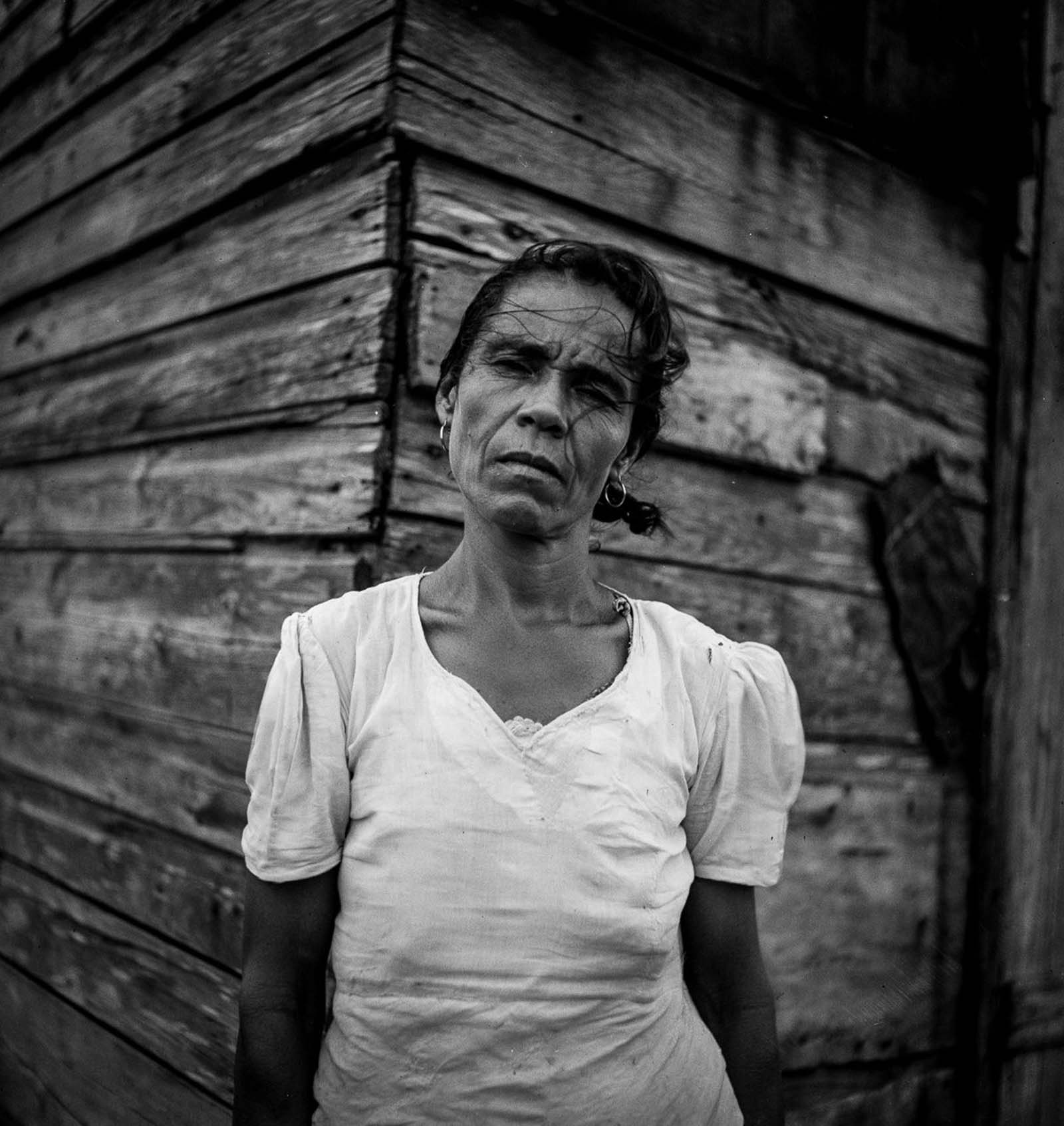 A woman who lives on land in Santurce that the FSA is buying for a land and utility housing project.