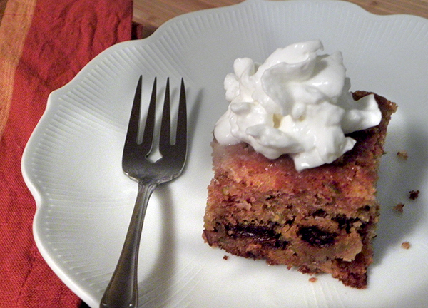 slice of apple cake with whipped cream