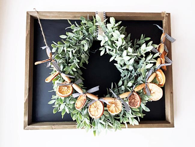 orange slice garland on a wreath