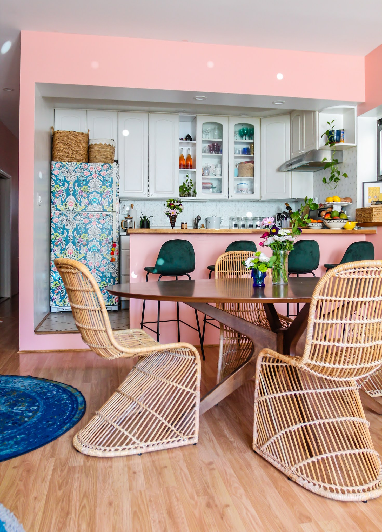 pink and green decor // green barstools // pink kitchen // diy wallpaper fridge // pink and green kitchen // colorful homes // Megan Zietz  Apartment // TfDiaries // pink and green room // pink and green Inspo // barstool inspo //rattan s chairs // mid century modern decor