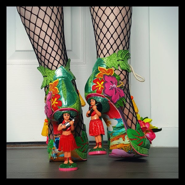 hula girl character heeled shoes shown with fishnet tights and patterned Hawaii printed soles