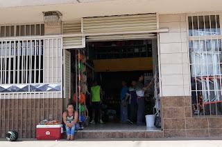 vendor in front of store in Santiago de Puriscal