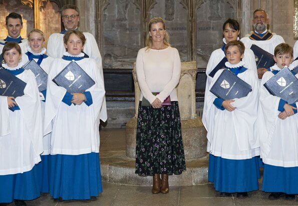 Countess of Wessex visited to join us in celebrating 25 years of Girl Choristers in Wells Cathedral Choir. floral print skirt and pink wool sweater