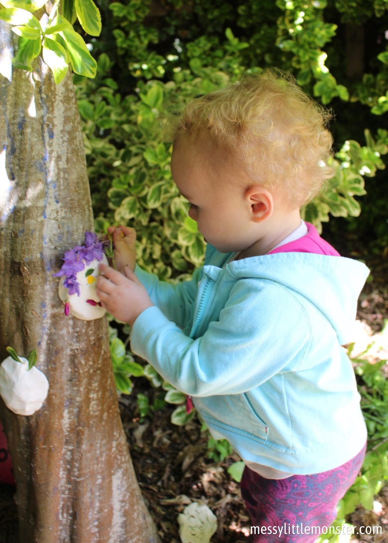 Outdoor art for kids - nature and clay faces