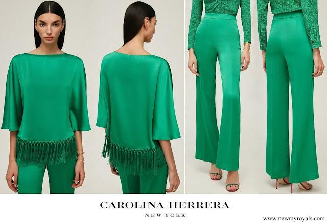 Queen Mathilde wore Carolina Herrera fringed crepe top and crepe straight leg pants green