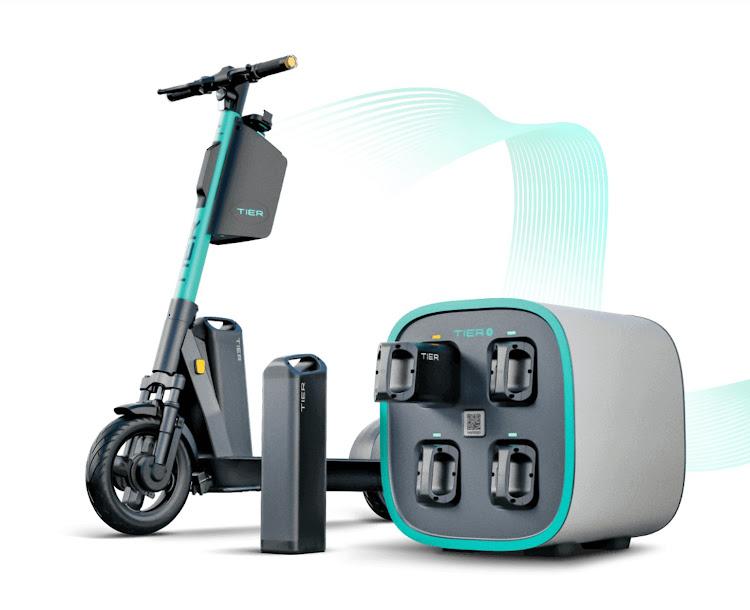 Скутер и зарядная станция Tier Mobility