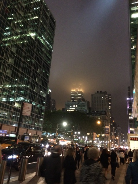 New York City at night, Empire State Building half hidden in the mist