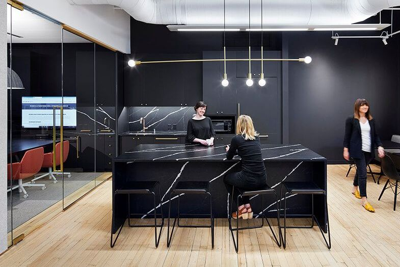 Black kitchen with marble island