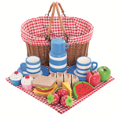 image of a wicker basket, red gingham cloth, wooden cups and food