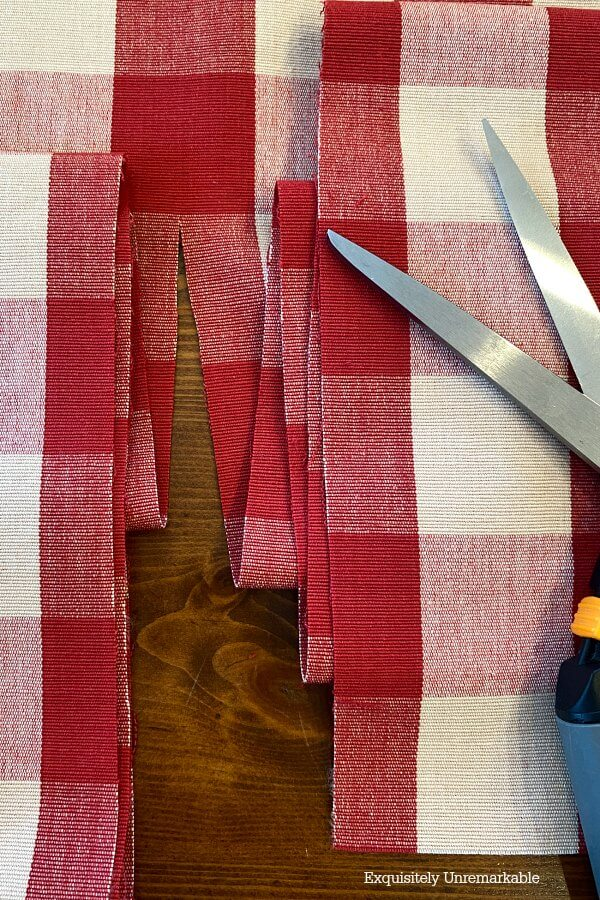 Cutting Red Checked Fabric Down the center of a red line