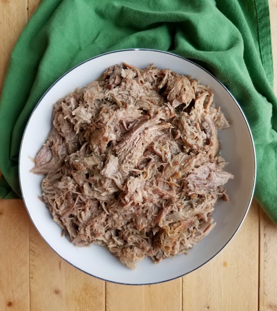 bowl of slow cooked apple cider pulled pork