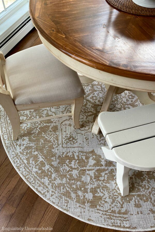 Beige rug under round kitchen table