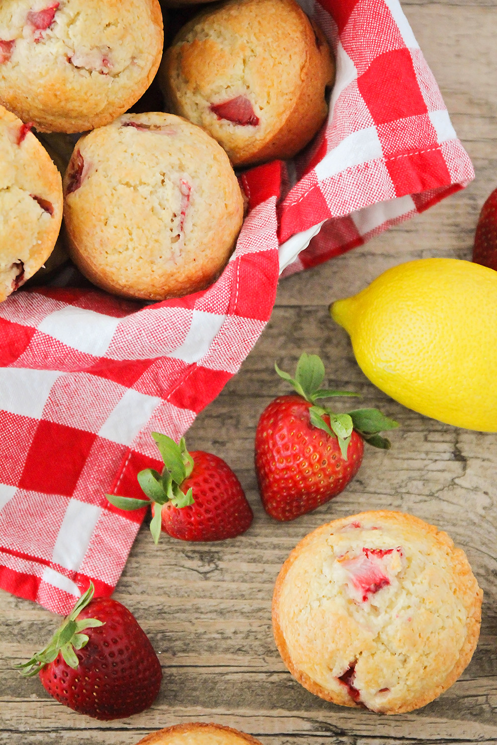 These strawberry lemonade muffins are so light and tender, and so flavorful too! They're bursting with juicy strawberries, and perfect for breakfast or brunch.