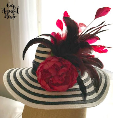 straw hat red peony red feathers