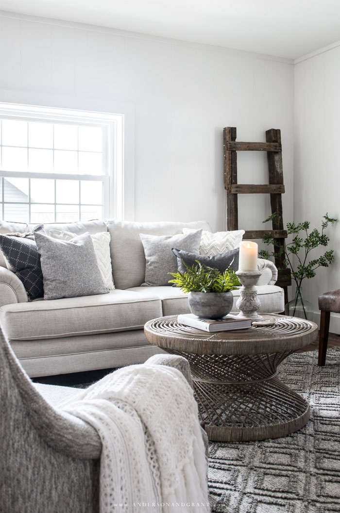 Wicker coffee table in front of beige sofa