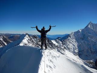 Man on Summit of Mountain