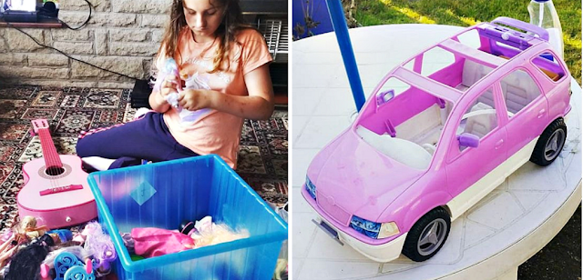 My daughter with a box of dolls and a pink Barbie car