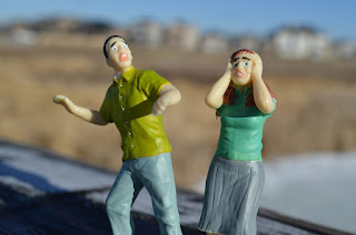 two plastic figurines that look frightened