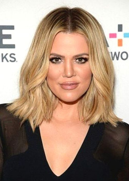 Flattering Hairstyles for Oval Face - Center-Parted Wavy Bob