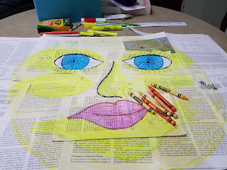 sunshine collage art with face and crayons