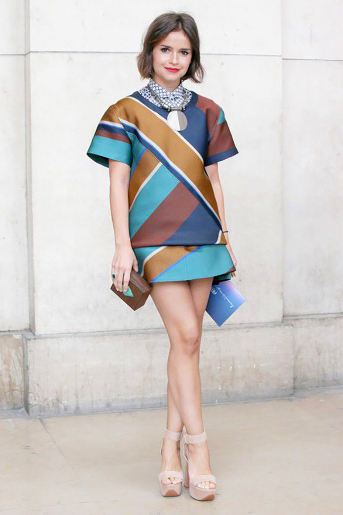 Miroslava Duma wears her colourful skirt suit with a collared shirt and box clutch as a street style star