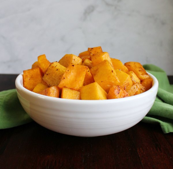 serving bowl filled with cubes of air fryer roasted butternut squash