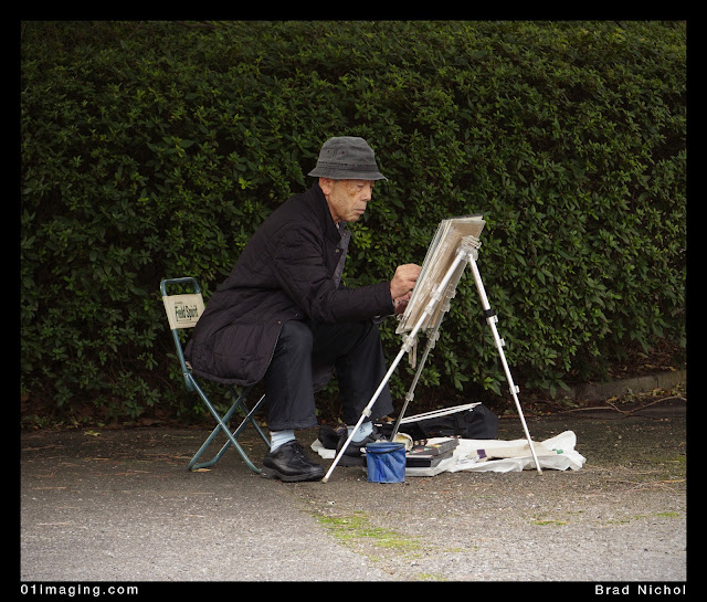 Painter in East garden imperial palace grounds, tokyo, japan, man with easel.