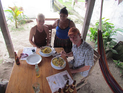 Canadians Mellta Swift (far left) and Chris Recek dining at Casa Nostra in Rio Dulce