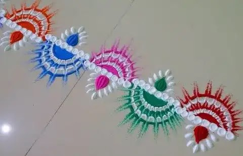 border rangoli design made up of diya