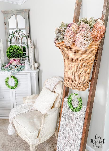 French bergere chair boxwood mantel blanket ladder French door baskeet dried hydrangeas