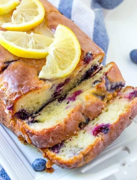 Lemon Blueberry Yogurt Cake - Lemon Blueberry Yogurt Cake is a moist, made-from-scratch lemon cake with fresh blueberries, lemon juice, simple syrup and a lemon glaze!