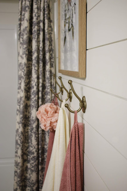 Inexpensive brass towel hooks in a bathroom